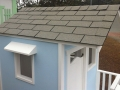 Blue Cubby House - Window Hoods and Laminate Shingles